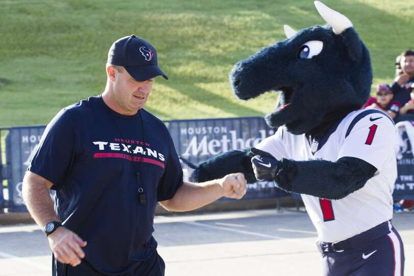 Day 2: July 27  Head coach Bill O'Brien, left, is greeted by Texans