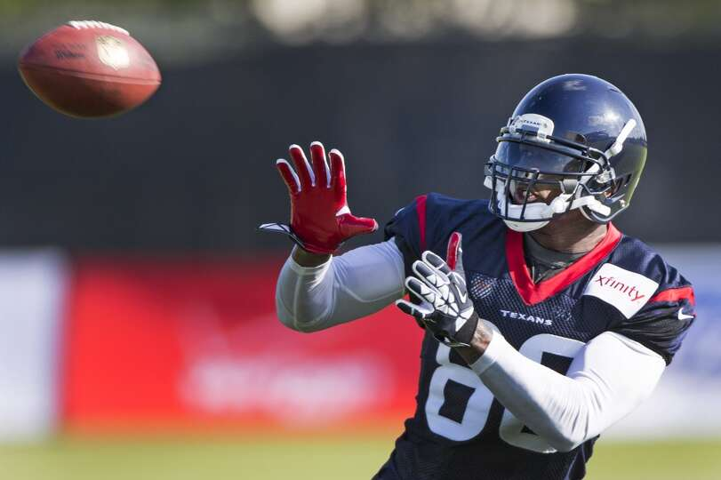Day 2: July 27  Wide receiver Andre Johnson reaches out to make a c