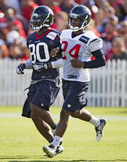 Day 2: July 27  Wide receiver Andre Johnson (80) and cornerback Joh