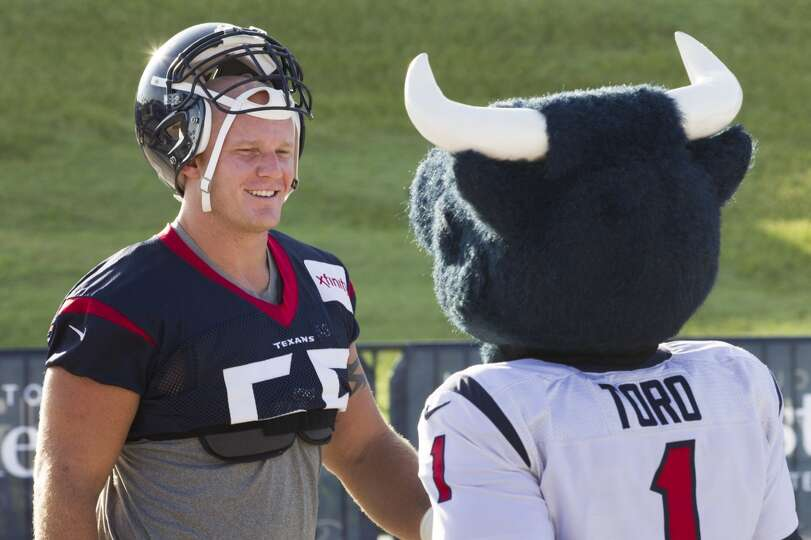 Day 2: July 27  Center Chris Myers, left, is greeted by Texans masc