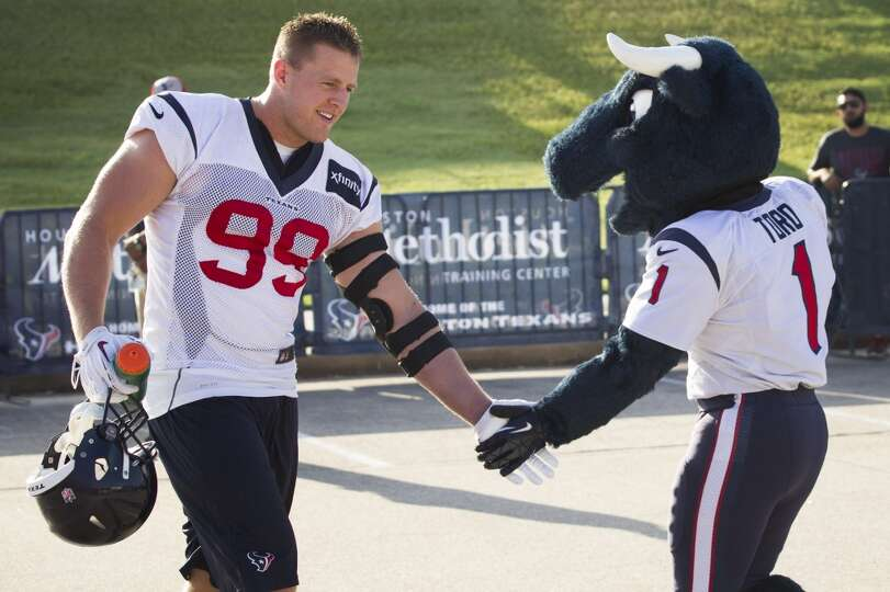 Day 2: July 27  Defensive end J.J. Watt, left, is greeted by Texans