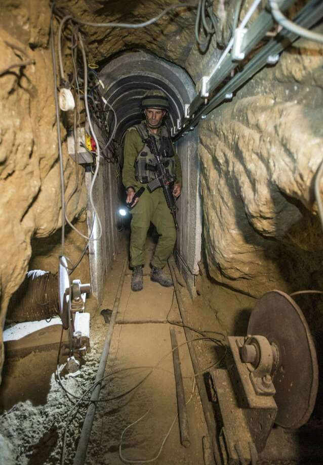 "An Israeli army officer gives journalists a tour, Friday, July 25, 2014, of a tunnel allegedly used by Palestinian militants for cross-border attacks, at the Israel-Gaza Border. A network of tunnels Palestinian militants have dug from Gaza to Israel, dubbed ""lower Gaza"" by the Israeli military, is taking center stage in the latest war between Hamas and Israel. Photo: Jack Guez, AP  / AP2014"