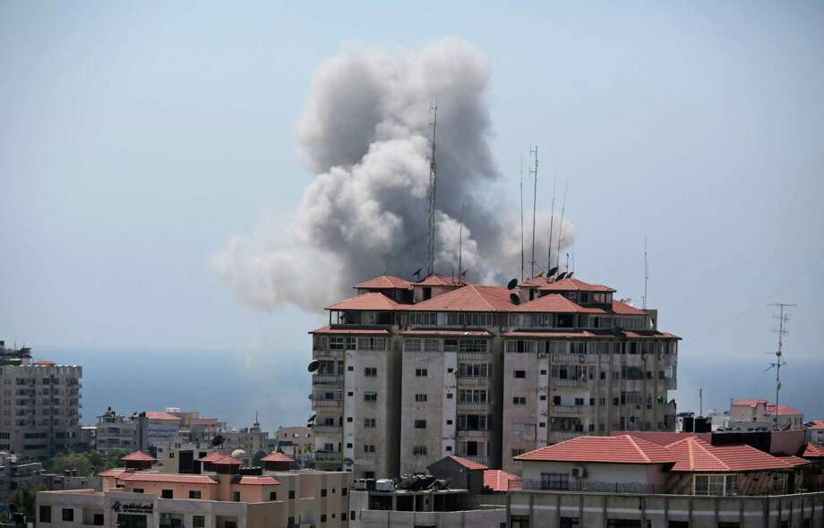 Smoke raises in the air following an Israeli strike in Gaza City on Sunday, July 27, 2014. Photo: Khalil Hamra, AP  / AP2014