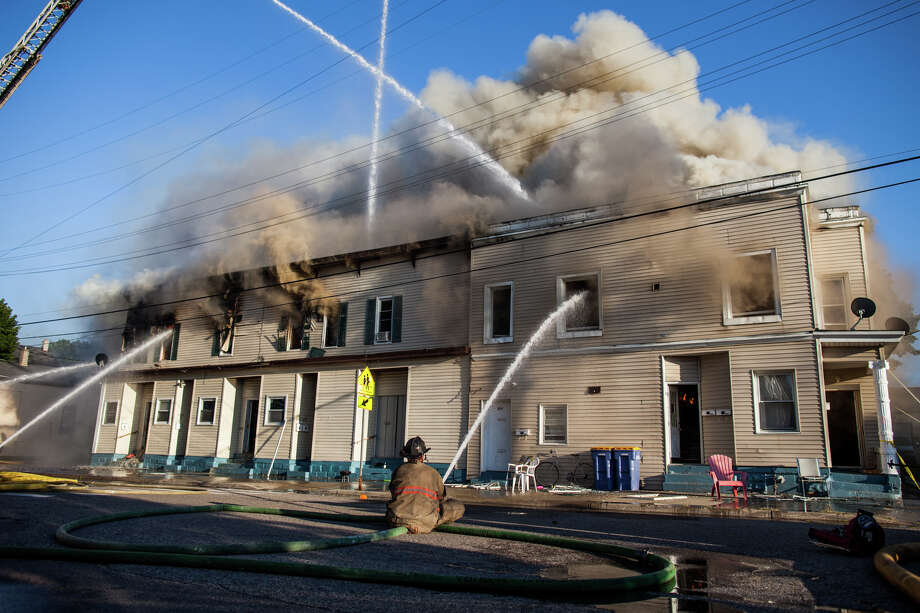 In this July 24, 2014 photo, firefighters battle an apartment fire in Grand Rapids, Mich. No injuries are reported following the Thursday evening fire, which sent smoke billowing into the air that was visible from far away.  Photo: Zach Gibson, AP  / The Grand Rapids Press