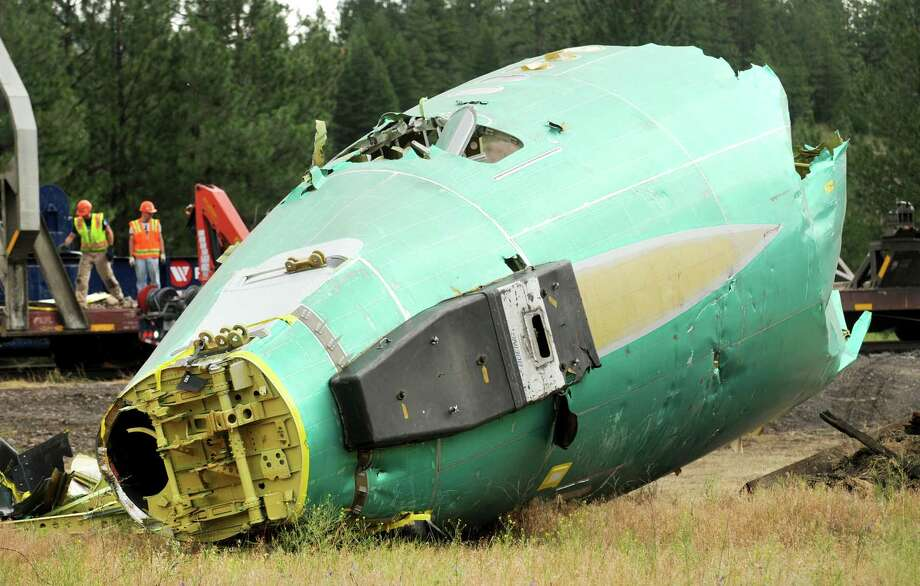 This Thursday, July 24, 2014 photo, shows the tail section of one of six Boeing 737 fuselages undergoing destruction at Rivulet, Mont. On July 3, 2014, six Boeing fuselages were damaged in a train derailment west of Alberton, Mont. Photo: Michael Gallacher, AP  / Missoulian