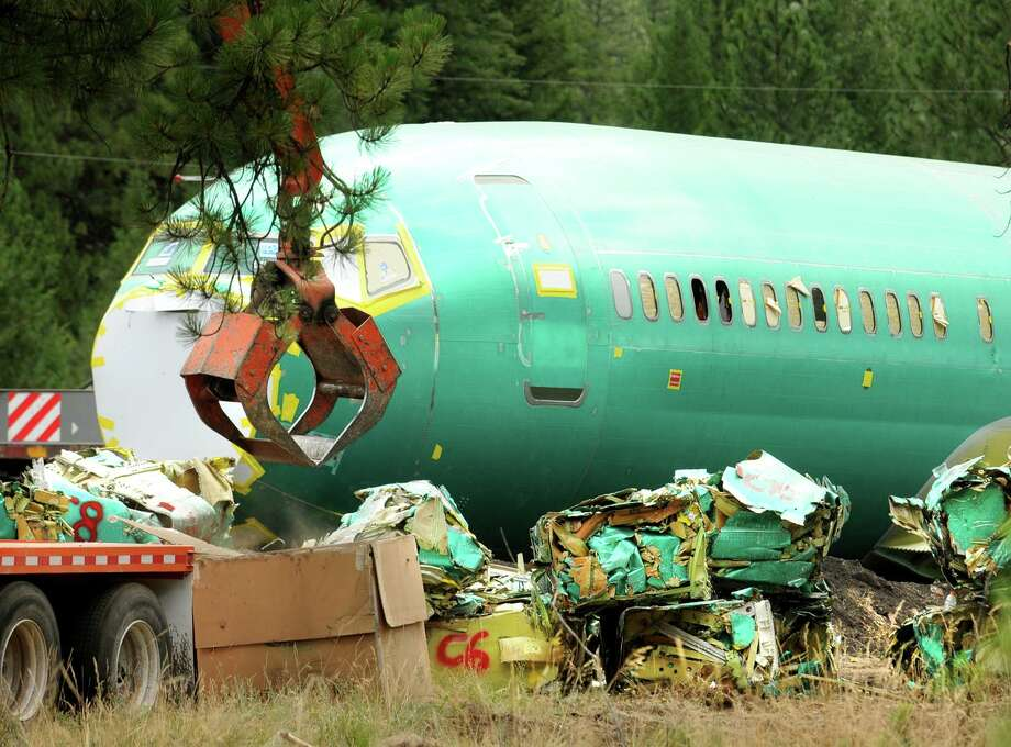In this Thursday, July 24, 2014 photo, bundles from crushed Boeing 737 fuselages sit next to a fuselage awaiting destruction at a temporary crushing yard near Fish Creek at Rivulet, Mont. On July 3, 2014, six Boeing fuselages were damaged in a train derailment west of Alberton. Photo: Michael Gallacher, AP  / Missoulian