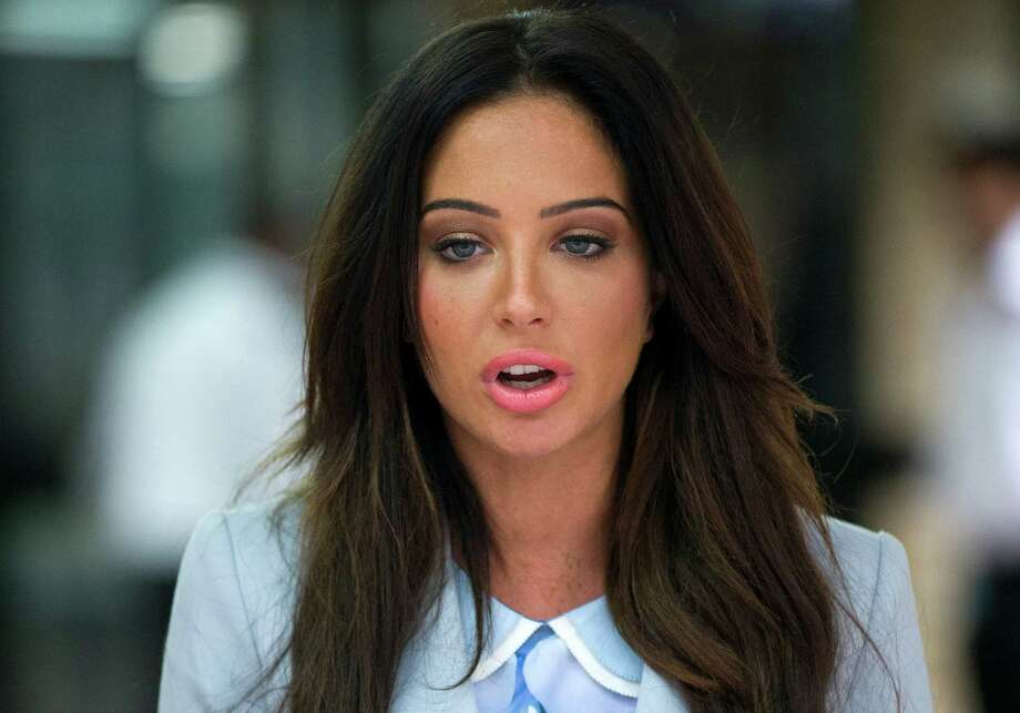 "British singer Tulisa Contostavlos delivers a statement after her trial over drugs allegations collapsed, outside Southwark Crown Court, London, Monday, July 21, 2014. The drug trial of Contostavlos collapsed after the judge said an undercover reporter known as the ""Fake Sheikh"" probably lied under oath. The Rupert Murdoch-owned Sun on Sunday tabloid reported last year that it had caught singer and TV talent-show judge Tulisa Contostavlos acting as a go-between in a deal to sell cocaine to a reporter posing as a wealthy film producer. (AP Photo/PA, Justin Tallis) UNITED KINGDOM OUT, NO SALES, NO ARCHIVE Photo: Justin Tallis, AP  / AP2014"