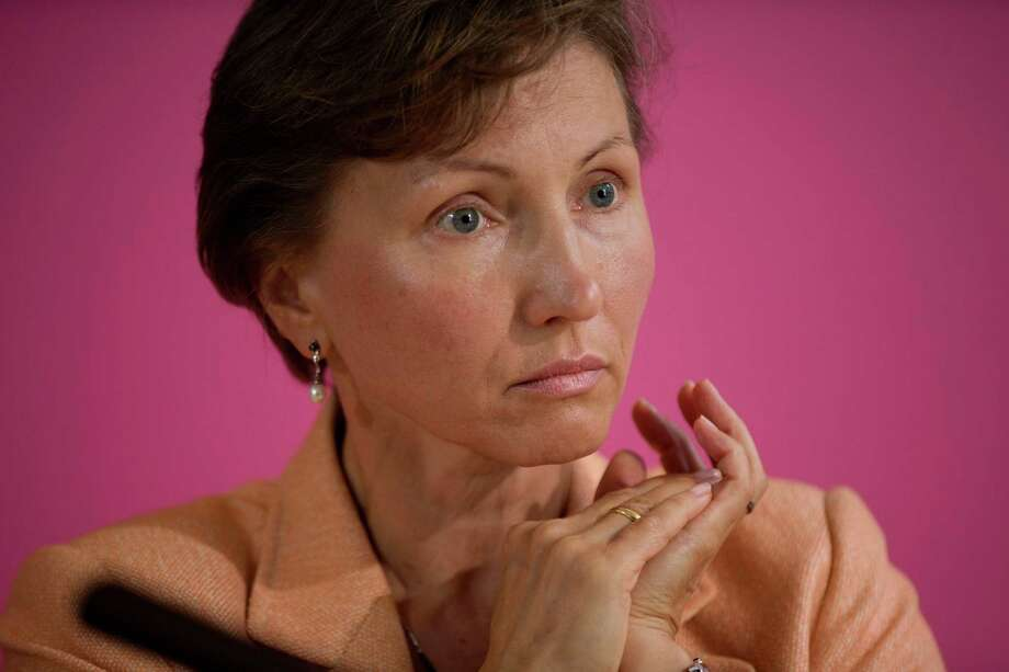 Marina Litvinenko, the widow of former Russian intelligence officer Alexander Litvinenko, listens during a press conference at her lawyer's offices in London, Tuesday, July 22, 2014.  The British government Tuesday announced plans for a wide-ranging public inquiry into the 2006 death of poisoned ex-Russian spy Alexander Litvinenko.  The decision, which comes at a time of rising tensions with Russia, means investigators can look into whether the Russian state played a role in Litvinenko's demise. Photo: Matt Dunham, AP  / AP2014