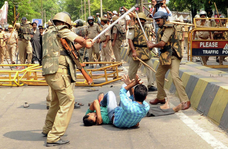Policemen lathicharging to disperse a procession led by Shia Cleric Kalbe Jawwad (not in picture) to gherao the residence of Uttar Pradesh Waqf Minister Mohd. Azam Khan against his efforts to allegedly sneak in some corrupt office bearers in the Shia Waqf Board on July 25, 2014 in Lucknow, India. One person was killed and over two dozen others injured during the clash. Photo: Hindustan Times, Getty Images / 2014 Hindustan Times