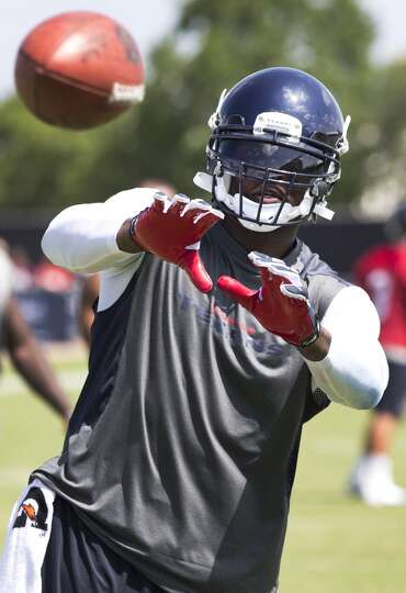 Day 2: July 27  Wide receiver Andre Johnson reaches out to catch a
