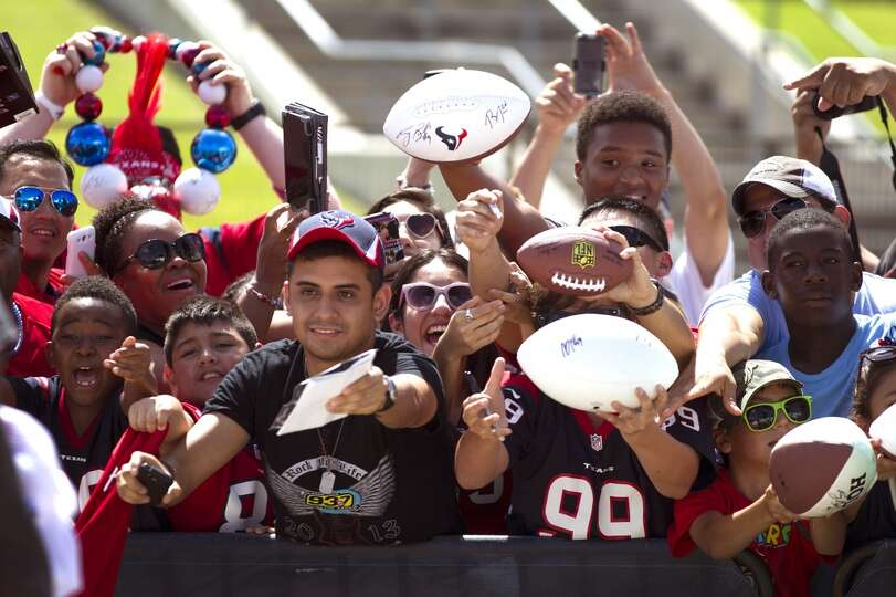 Day 2: July 27  Fans seek autographs during Texans training camp.
