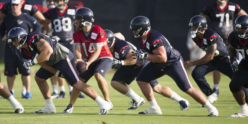 Day 2: July 27  Quarterback Ryan Fitzpatrick (24) takes a snap from