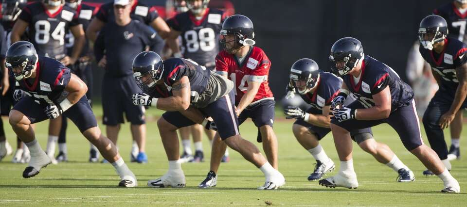 Day 2: July 27  Offensive linemen Cody White, left, Chris Myers, ce