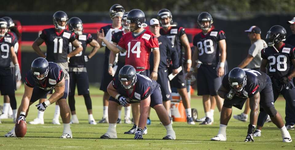 Day 2: July 27  Offensive linemen Chris Myers, left, Ben Jones and