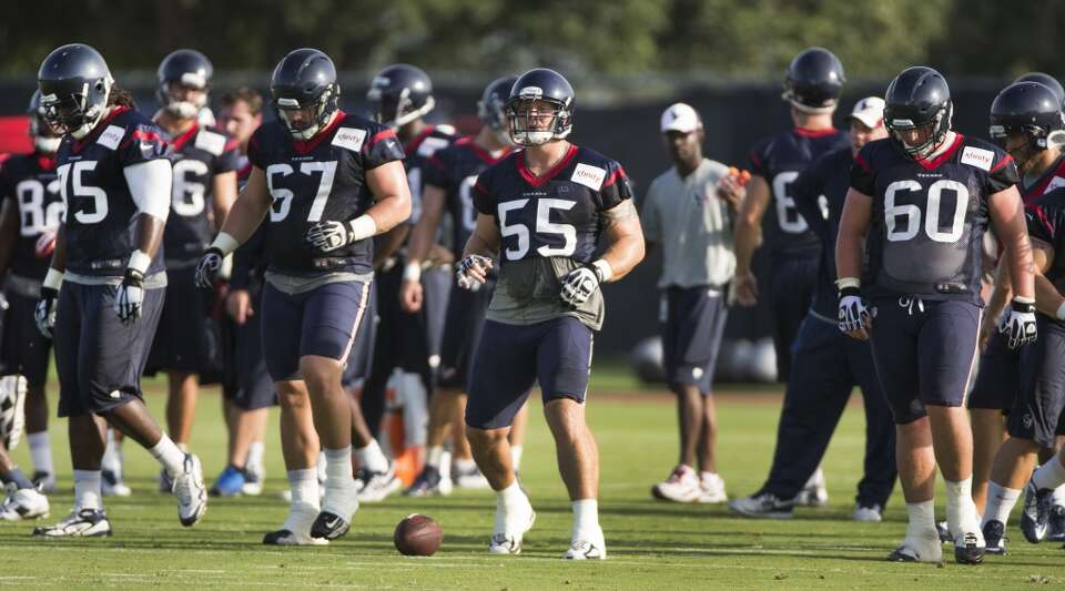 Day 2: July 27  Offensive linemen Derek Newton (75), Cody White (67