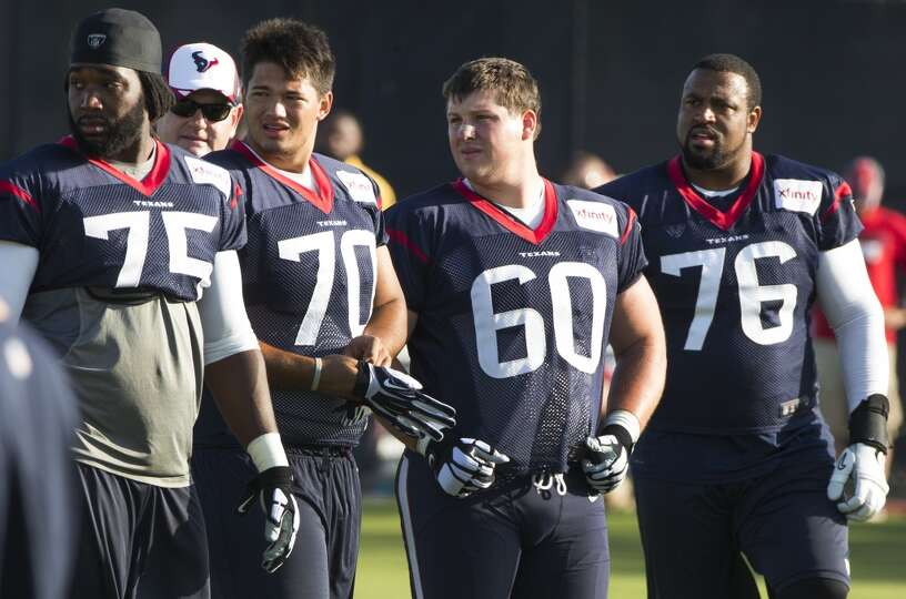 Day 2: July 27  Offensive linemen Derek Newton (75), Xavier Su'a-Fi