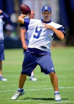 Dallas Cowboys quarterback Tony Romo throws a pass during NFl football training camp, Thursday, July 24, 2014, in Oxnard, Calif. (AP Photo/Gus Ruelas) Photo: Gus Ruelas, Associated Press / FR157633 AP