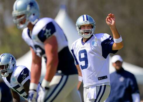 Dallas Cowboys quarterback Tony Romo (9) call an audible as the offense runs a play at NFL training camp, Saturday, July 26, 2014, in Oxnard, Calif. (AP Photo/Gus Ruelas) Photo: Gus Ruelas, Associated Press / FR157633 AP