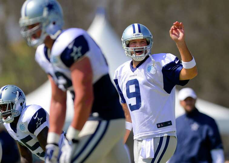 Dallas Cowboys quarterback Tony Romo (9) call an audible as the offense runs a play at NFL training