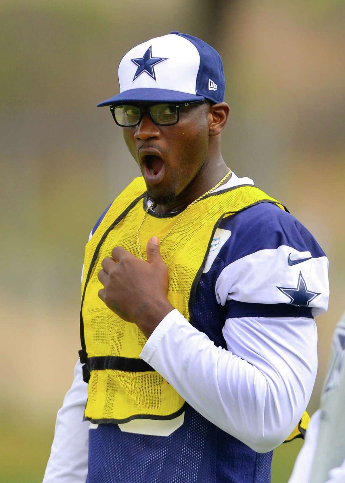 Dallas Cowboys linebacker Rolando McClain makes his first day of practice since his retirement during Dallas Cowboy's NFL training camp, Saturday, July 26, 2014, in Oxnard, Calif. (AP Photo/Gus Ruelas)