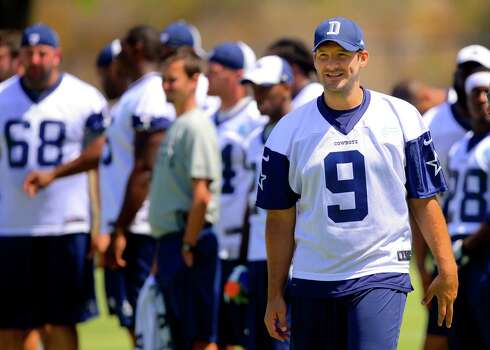 Dallas Cowboys quarterback Tony Romo during Dallas Cowboy's training camp, Friday, July 25, 2014, in Oxnard, Calif. (AP Photo/Gus Ruelas) Photo: Gus Ruelas, Associated Press / FR157633 AP