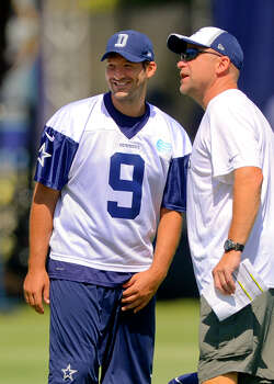 Dallas Cowboys quarterback Tony Romo talks with member of the coaching staff during Dallas Cowboy's training camp, Friday, July 25, 2014, in Oxnard, Calif. (AP Photo/Gus Ruelas) Photo: Gus Ruelas, Associated Press / FR157633 AP