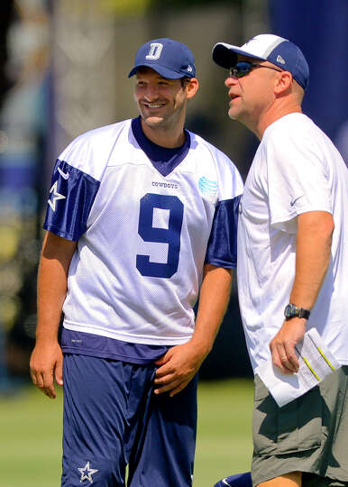 Dallas Cowboys quarterback Tony Romo talks with member of the coaching staff during Dallas Cowboy's