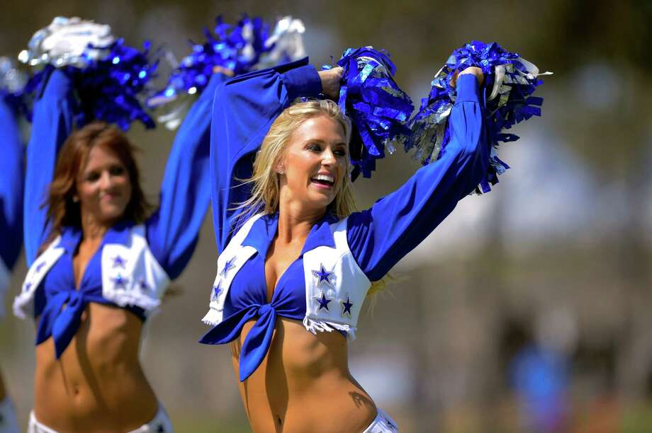 The Dallas Cowboys cheerleaders perform as part of opening day ceremonies and the official start of the Dallas Cowboy's NFL training camp, Saturday, July 26, 2014, in Oxnard, Calif. (AP Photo/Gus Ruelas) Photo: Gus Ruelas, Associated Press / FR157633 AP