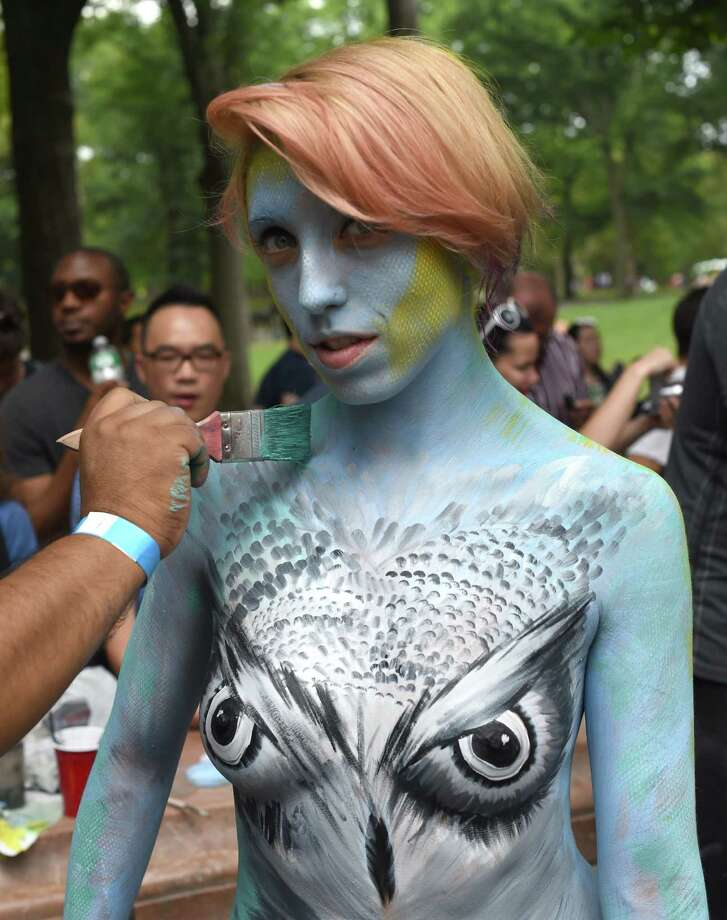 More than 25 body-painting artists from across the U.S. attempt to paint about 30 naked models during an event  at Columbus Circle July 26, 2014. After a legal battel with New York City, the event took place in the only city in the country that allows it . AFP PHOTO / Timothy A. CLARY Photo: TIMOTHY A. CLARY, Getty Images / AFP
