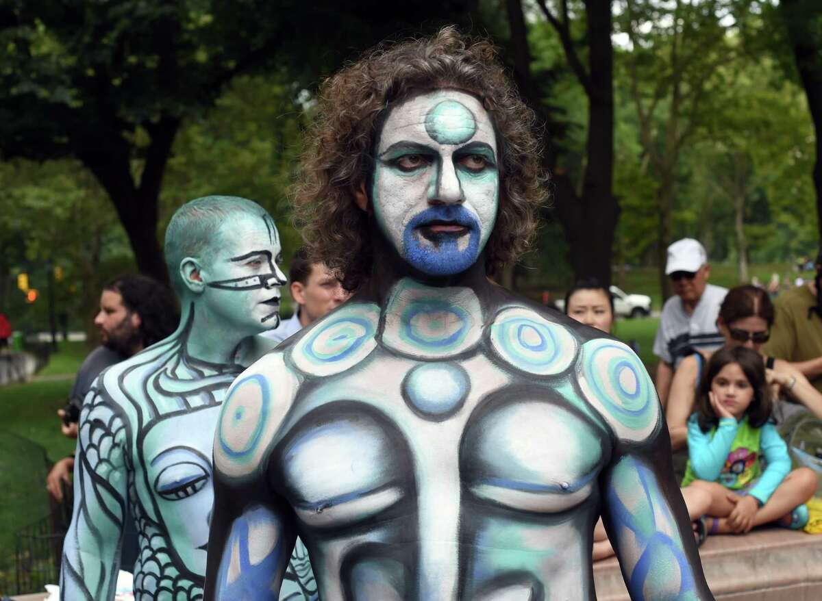 More than 25 body-painting artists from across the U.S. attempt to paint about 30 naked models during an event at Columbus Circle July 26, 2014. After a legal battel with New York City, the event took place in the only city in the country that allows it . AFP PHOTO / Timothy A. CLARY