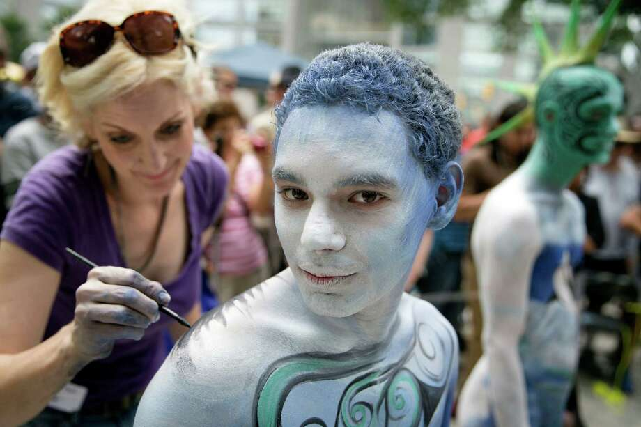 Crist Crow is painted at Columbus Circle as body-painting artists gathered to decorate nude models as part of an event featuring artist Andy Golub, Saturday, July 26, 2014, in New York. Golub says New York was the only city in the country that would allow his inaugural Bodypainting Day. Photo: John Minchillo, AP  / AP2014