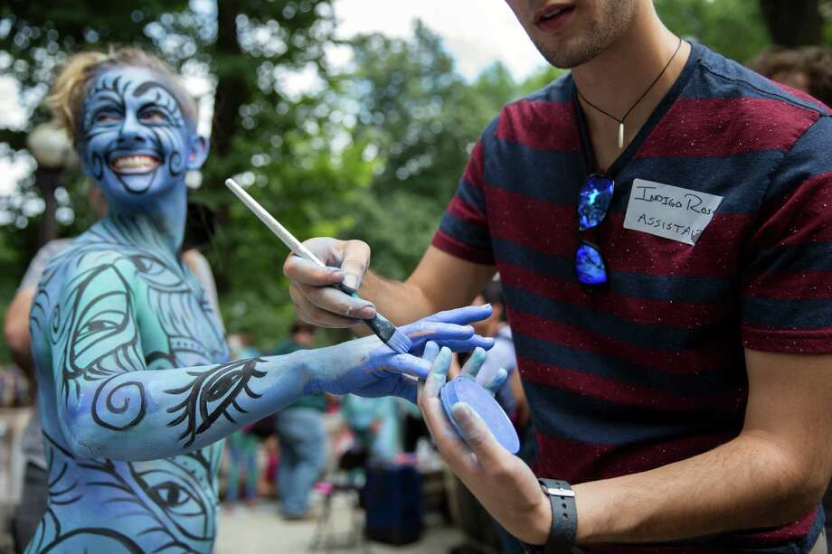 A nude model is decorated by a body-painting artist as part of an event featuring artist Andy Golub, Saturday, July 26, 2014, in New York. Golub says New York was the only city in the country that would allow his inaugural Bodypainting Day. Photo: John Minchillo, AP  / FR170537 AP