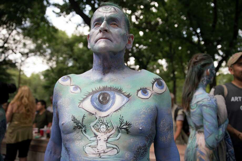 Jack van Riper, of New Jersey, stands for a photograph after being painted at Columbus Circle as body-painting artists gathered to decorate nude models as part of an event featuring artist Andy Golub, Saturday, July 26, 2014, in New York. Golub says New York was the only city in the country that would allow his inaugural Bodypainting Day. Photo: John Minchillo, AP  / AP2014
