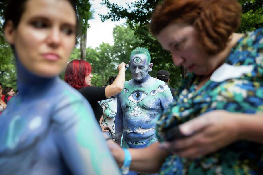 Jack van Riper, of New Jersey, is painted at Columbus Circle as body-painting artists gathered to decorate nude models as part of an event featuring artist Andy Golub, Saturday, July 26, 2014, in New York. Golub's event Saturday included a post-painting march down Broadway and a return to Times Square for a photo shoot. Photo: John Minchillo, AP  / AP2014