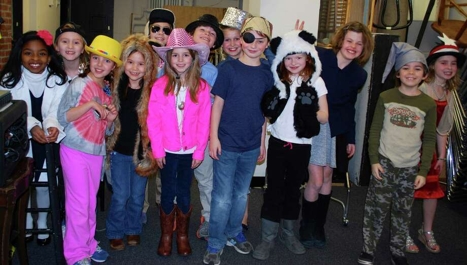 A recent kids' theater class at the Darien Arts Center gets ready backstage for a performance at the DAC Weatherstone Studio. Registration for fall classes at the DAC is available at darienarts.org. Photo: Contributed Photo, Contributed / Darien News