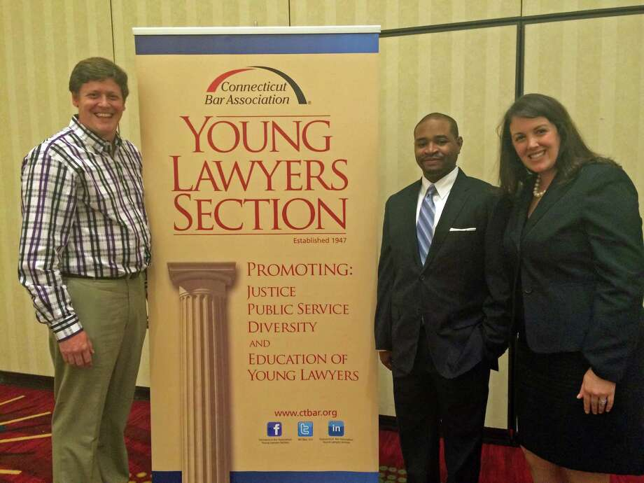 "Darien resident and CBA-YLS ""Star of the Year"" honoree Walter B. Welsh, left, meets with retreat keynote speaker the Honorable Raheem L. Mullins, Connecticut Appellate Court, and CBA-YLS Chairman Emily Graner Sexton. Photo: Contributed Photo, Contributed / Darien News"