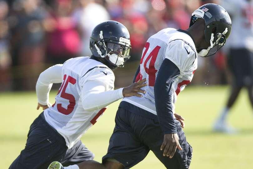 Day 2: July 27  Cornerback Kareem Jackson (25) runs through a cover