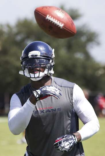 Day 2: July 27  Wide receiver Andre Johnson flips a ball in the air