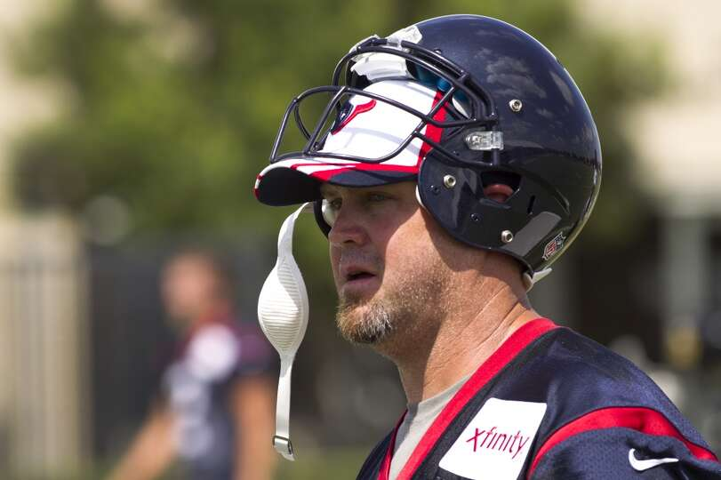 Day 2: July 27  Punter Shane Lechler walks off the field following