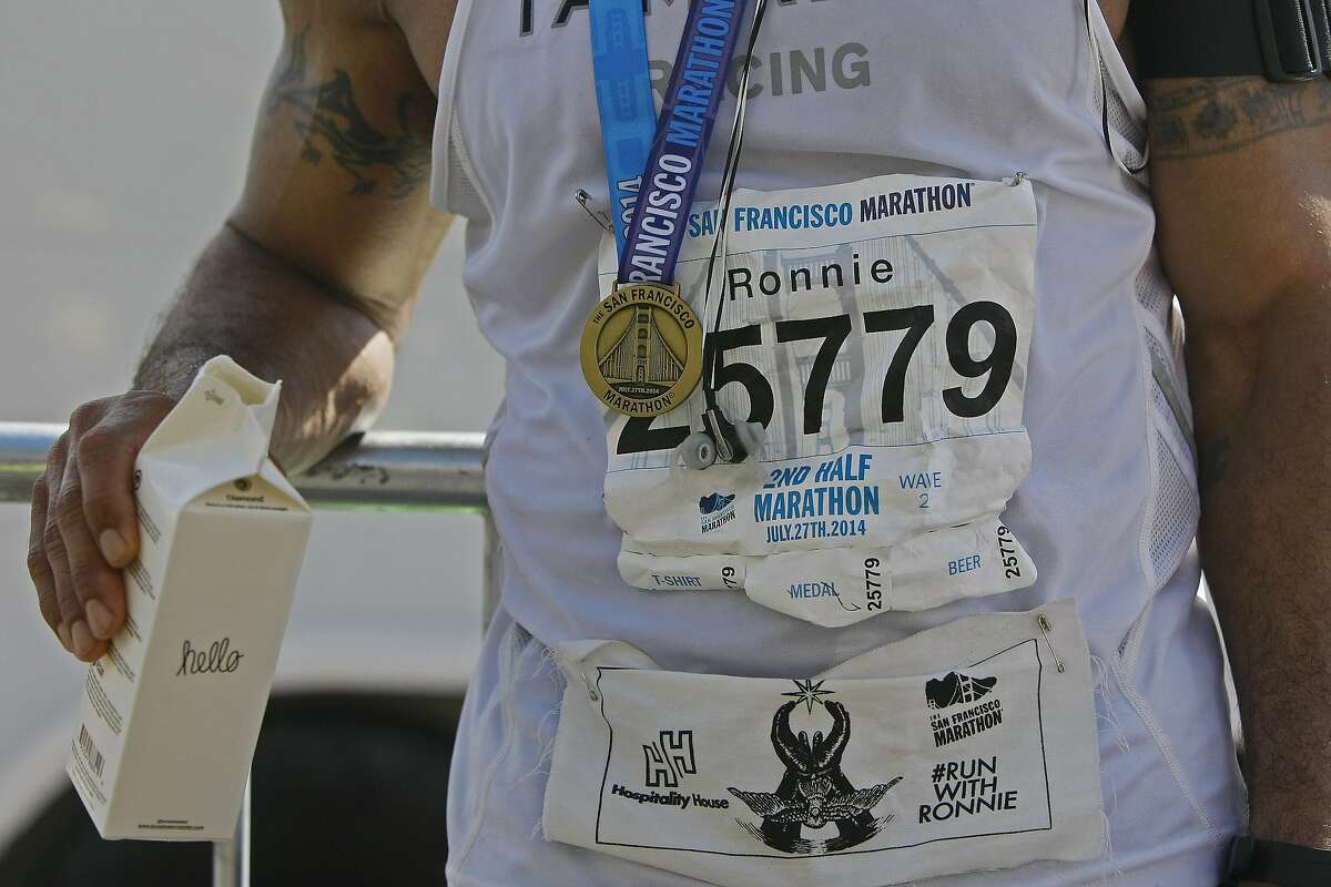 Ronnie Goodman relaxes after finishing the San Francisco Marathon on Sunday, July 27, 2014 in San Francisco, Calif. Goodman is a homeless artist who lives in a tent under the freeway who has long dreamed of running in the marathon.