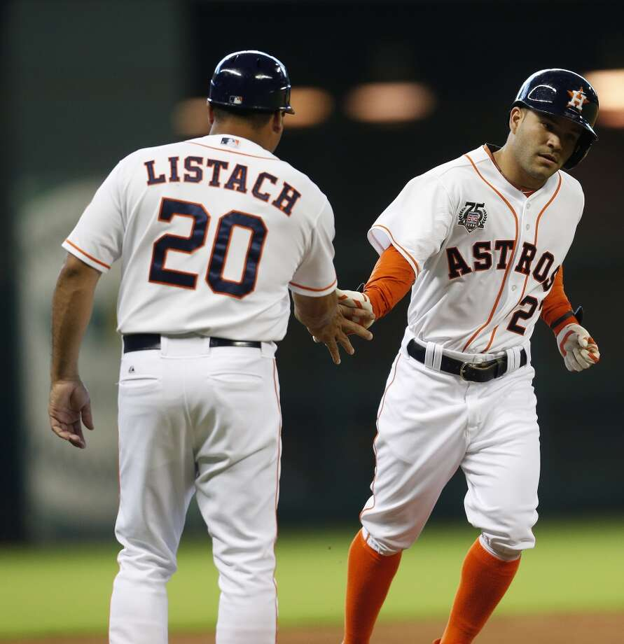 Astros second baseman Jose Altuve (27) rounds third base and after his home run in the first inning. Photo: Karen Warren, Houston Chronicle