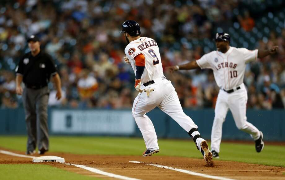 Astros shortstop Marwin Gonzalez (9) runs around around first after his single with a Marlins throwing error allowing him to take second base. Photo: Karen Warren, Houston Chronicle