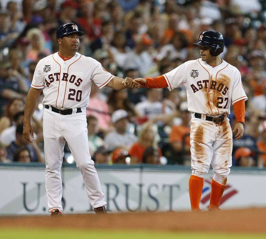 Astros second baseman Jose Altuve (27) on third base with Astros third base coach Pat Listach (20). Photo: Karen Warren, Houston Chronicle