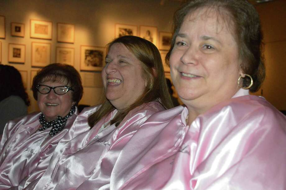 "Several people in the audience wore1950s-appropriate costumes to the ""Grease"" sing-along from the Westport Library, from left, Guggenheim, Michelle Krancz and Gail Parda. Photo: Jarret Liotta / Westport News"