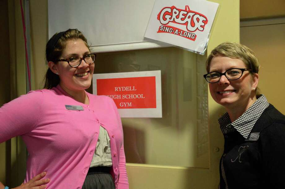 "Jaina Lewis, left, Westport Library's teen librarian, and Kelle Ruden, community relations director, hosted the ""Grease"" sing-along at the library Saturday afternoon. Photo: Jarret Liotta / Westport News"
