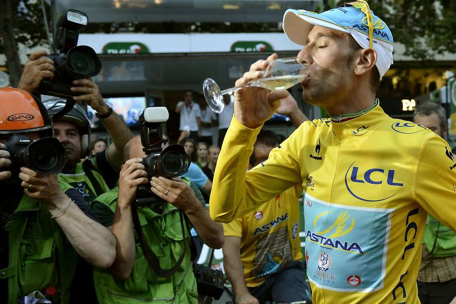 Italy's Vincenzo Nibali takes the traditional sip of Champagne on the Champs-Elysees in Paris. Photo: Jeff Pachoud, AFP/Getty Images
