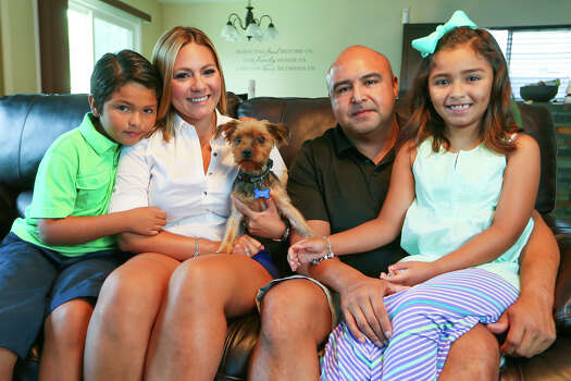 Aidan Delgado (from left), 7, Yvette Castillo, Juan Delgado and Leila Delgado, 7, with Brody, their six-year-old Yorkshire Terrier Brody was picked up by Animal Care Services on July 16 after being missing for sixteen months.  ACS identified Brody from his microchip and notified the family.  Photo by Marvin Pfeiffer / EN Communities Photo: MARVIN PFEIFFER, San Antonio Express-News / EN Communities 2014