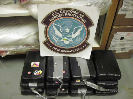 In this Nov. 23, 2009 photo provided by the U.S. Customs and Border Protection, 29.6 pounds of heroin seized at the El Paso, Texas, port of entry are shown. The heroin was hidden under the front seats of a car trying to cross into the United States from Ciudad Juarez at a downtown bridge. The driver, Juan Carlos Martinez of Chaparral, N.M., and passenger, Perla A. Ortiz of Anthony, N.M., both 18, were arrested on federal drug charges. (AP Photo/U.S. Customs and Border Protection) Photo: AP / U.S. Customs and Border Protecti