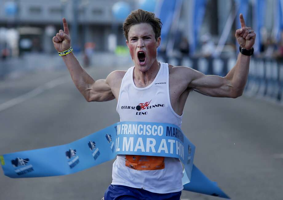 August Brautigam of Reno celebrates his first-place finish in the men's division of the full S.F. Marathon. Photo: Brant Ward, San Francisco Chronicle