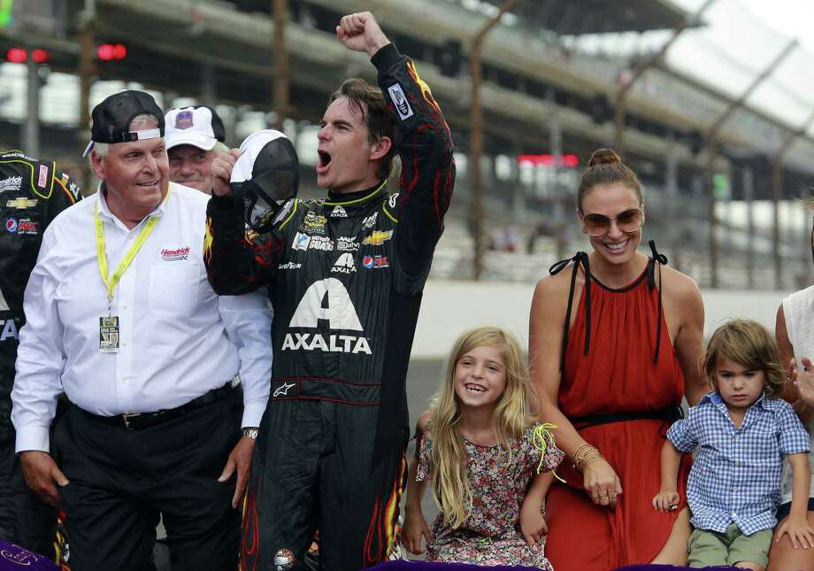 Jeff Gordon celebrates after winning at the Brickyard 400 with team owner Rick Hendrick (left), his wife Ingrid Vandebosch, and their children, Ella Sofia and Leo Benjamin. Photo: R Brent Smith / Associated Press / FR171017 AP